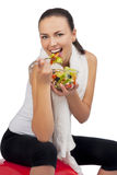 Caucasian woman eating salad Royalty Free Stock Image