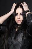 Caucasian woman in an elegant black dress royalty free stock photography