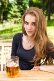 Caucasian woman enjoying beer on cafe Royalty Free Stock Images