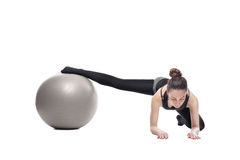 Caucasian woman exercising pilates Stock Photo