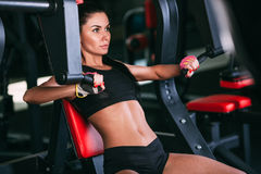 Caucasian woman exercising on shoulder press machine Royalty Free Stock Images