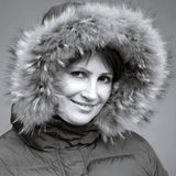 Caucasian woman in fur hood Royalty Free Stock Photos