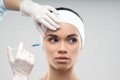 Caucasian woman getting cosmetic injection Royalty Free Stock Images