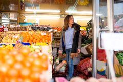 Caucasian woman in greengrocer`s shop Stock Image