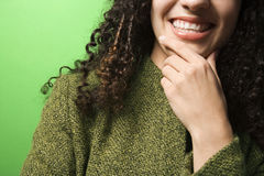 Caucasian woman with hand on chin wearing green clothing. Stock Photo