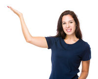 Caucasian woman with hand presentation Stock Photo