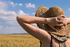 Caucasian woman  with hands behind head, staring at horizon on a sunny day. Caucasian woman  with hands behind head, staring at horizon on a summer day Royalty Free Stock Photo