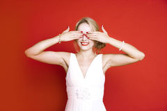 Caucasian woman with hands over her eyes Royalty Free Stock Image