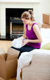 Caucasian woman having a break between boxes