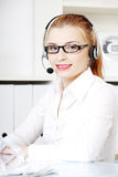 Caucasian woman in headset. Stock Photo
