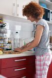 Caucasian woman in her kitchen Stock Photography