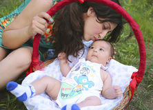 Caucasian woman with her little son in park. Beautiful caucasian women with her little infant son in park Royalty Free Stock Photo