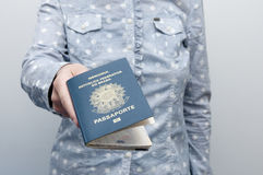 Caucasian Woman holding a brazilian passport Royalty Free Stock Photos