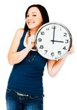 Caucasian woman holding clock Stock Images