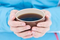 Caucasian woman holding cup of hot tea at winter outdoor. Royalty Free Stock Photo