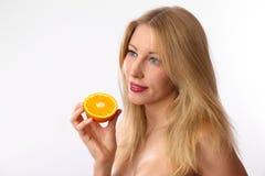 Caucasian woman holding orange Royalty Free Stock Photos