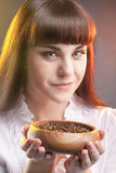 Caucasian Woman Holding  Wooden Cup with Brown Coffee Beans Royalty Free Stock Photography