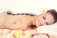 Caucasian woman hot stone massage wellness Stock Photography