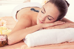 Caucasian woman hot stone massage wellness Royalty Free Stock Photo