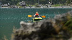 Caucasian Woman in the Inflatable Kayak stock footage