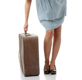 Caucasian woman legs with travel case Stock Photos