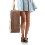 Caucasian woman legs with travel case Stock Photo