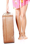 Caucasian woman legs with travel case Royalty Free Stock Photo