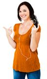 Caucasian woman listening media player Stock Image