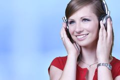 Caucasian woman listens to headphones Royalty Free Stock Images