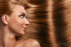 Caucasian woman with long beautiful hair Stock Photos