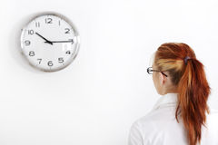 Caucasian woman looking at the clock royalty free stock photography