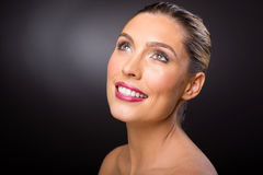 Caucasian woman looking up. Happy caucasian woman looking up on black background Stock Photo