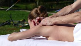 Caucasian woman lying on a massage table stock footage