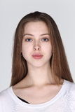 Caucasian Woman before make up hair do. no retouch, fresh face w. Ith acne then cosmetic foundation by professional artist in studio lighting white background Royalty Free Stock Images