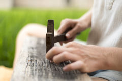 Caucasian woman makes handmade  board with nails Royalty Free Stock Photo