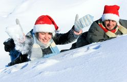 Caucasian woman and man laying on the snow Stock Photo