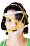 Caucasian woman with measuring tape on face Royalty Free Stock Image