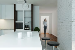 Caucasian woman in modern kitchen interior Stock Image