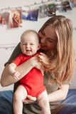 Caucasian woman mother holding cute adorable baby boy girl child