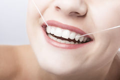 Caucasian Woman Mouth Closeup with Dental Floss. Horizontal Image royalty free stock photography