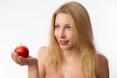 Caucasian woman offering apple Stock Image