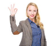 Caucasian woman with ok sign Stock Image