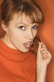 Caucasian woman on orange background. Caucasian mid-adult woman with sexy expression on orange background Stock Images