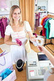 Caucasian woman paying items Stock Photos
