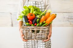 Free Caucasian Woman People With Bucket Full Of Coloured And Mixed Fresh Healthy Food Like Fruit And Vegetables Royalty Free Stock Photography - 168311827