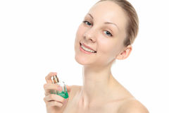 Caucasian woman with perfume Royalty Free Stock Image