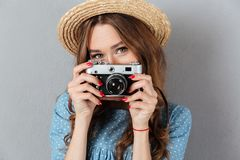 Caucasian woman photographer holding camera. Royalty Free Stock Photo