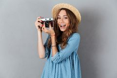 Caucasian woman photographer holding camera. Stock Images