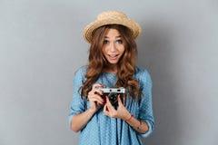 Caucasian woman photographer holding camera. Image of happy young caucasian woman photographer holding camera Stock Image