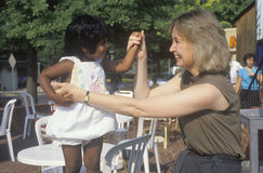 A Caucasian woman playing with an Indian child, Royalty Free Stock Image